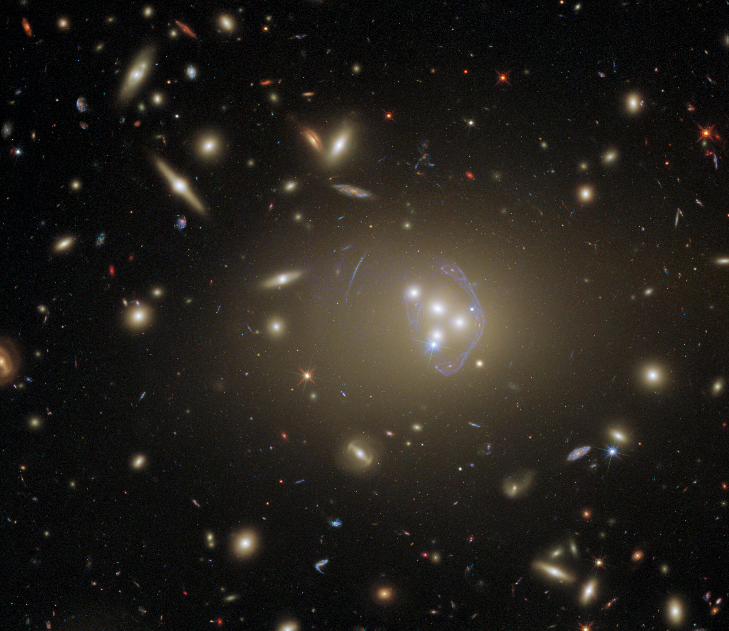 Hubble Gazes at a Cluster Full of Cosmic Clues